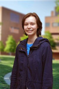 A three quarter portrait of Rachel on the Library green.
