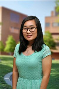 A three quarter portrait of Hye on the Library green.