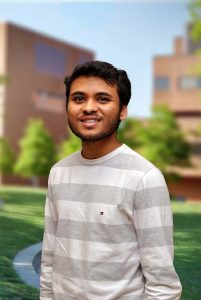 A three quarter portrait of Dhruvil on the Library green.