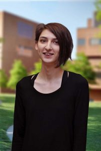 A three quarter portrait of Aline on the Library green.